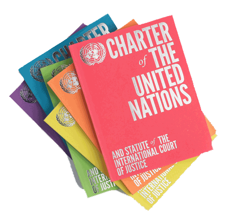 copies of the UN charter in a pile