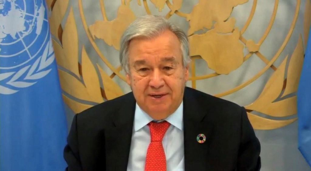 United Nations Secretary General seated at desk as he address Women's Civil Society Audience